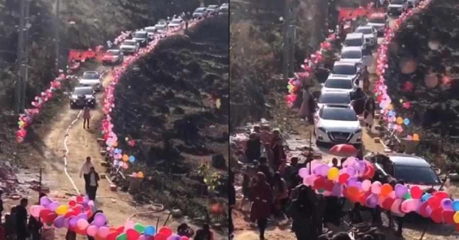 Đoàn xe rước dâu đang từ từ xuống dốc. (Ảnh: Cắt từ clip)