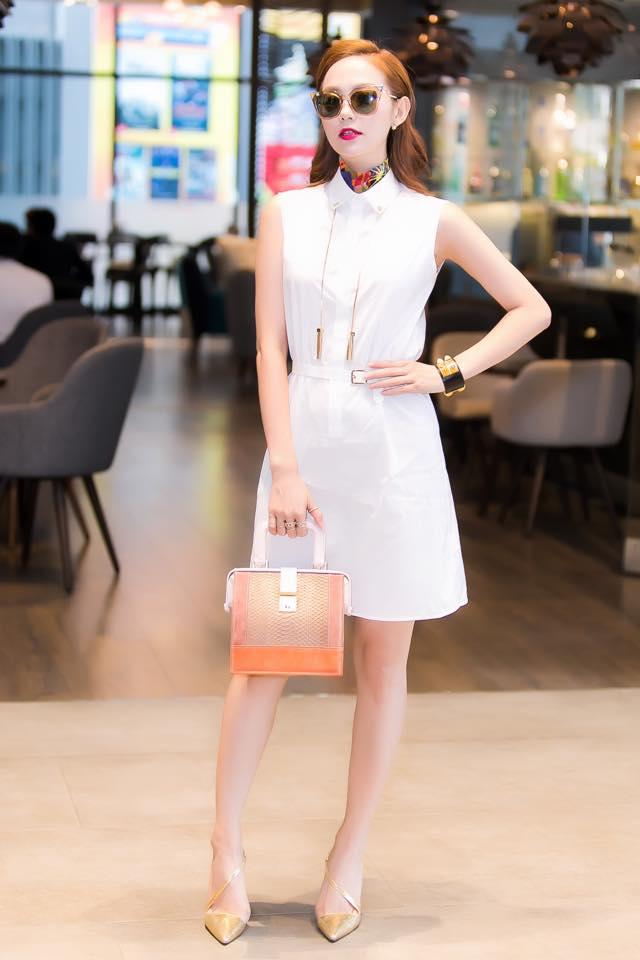 Học Minh Hằng diện váy trắng sành điệu và phụ kiện đa màu